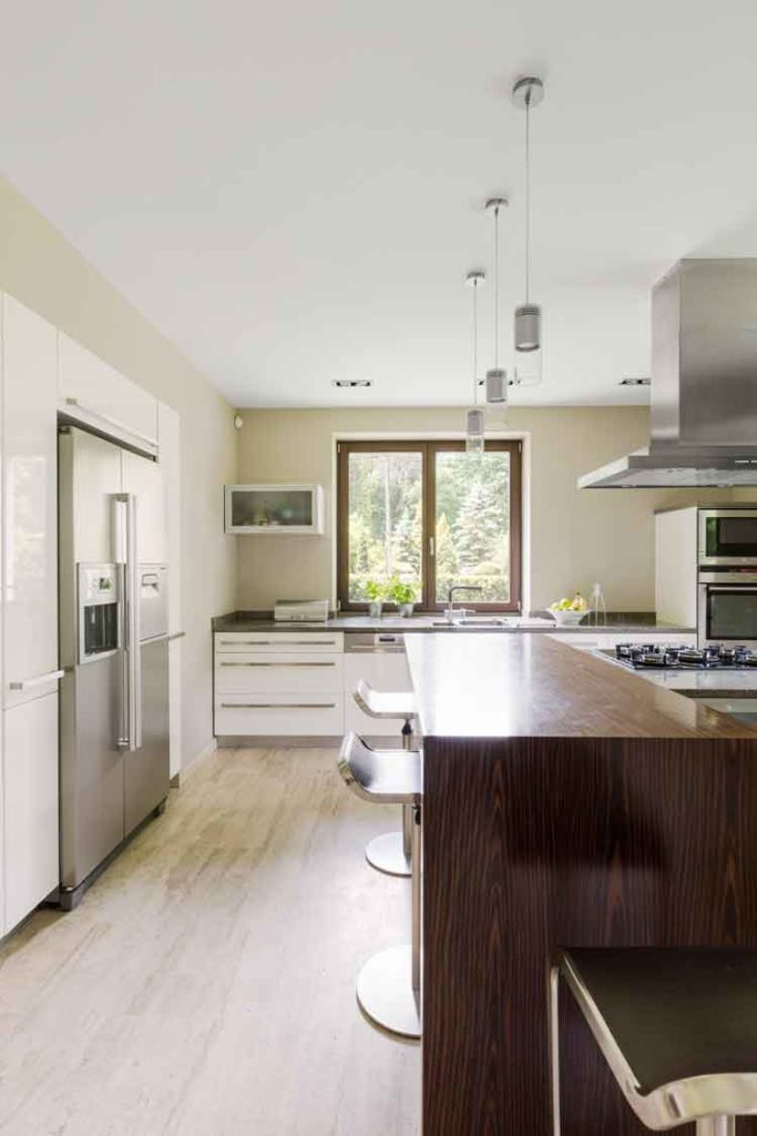 Image of beautiful modern kitchen featuring solid surface, granite, and engineered stone countertops by Earnest Watkins Construction professional commercial and residential remodeling in Panama City, Florida